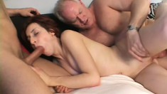 Sexy young redhead sucks a long cock and takes another deep in her juicy peach