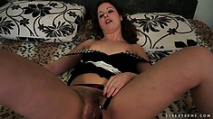 Hadjara, a beautiful brunette with tiny tits and a hairy cunt, is one horny babe
