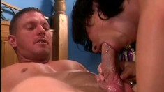 Lying on the bed, a desirable brunette gets her snatch and her ass drilled rough