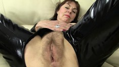 British lady in a black latex outfit Georgie exposes her needy holes