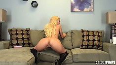 Sexy blonde hottie, Aaliyah Love poses in her bra and panties on the couch