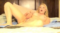 Pretty blonde tranny with big boobs stuffs a dildo deep inside her ass