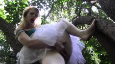 Madison Young lifts up her skirt so she can reach in and diddle her cunt