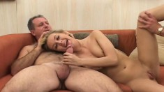 Pretty young blonde has two experienced guys sharing her tight pussy