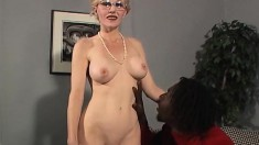 Big breasted blonde cougar in heat surrenders her cunt to a dark stud
