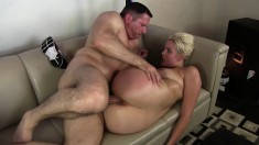 Bodacious blonde greases up her splendid curves and gets banged hard