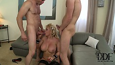 She's plugged from behind, eats cock and gets a load on her huge titties