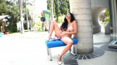 Voluptuous nympho with a heavenly ass plays with a big dildo outside