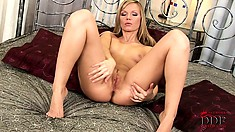 Marvelous blonde with cute tits and a hot ass sensuously plays with her twat on the bed