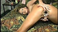 The busty milf fingers her peach while a big sex toy fills every inch of her fiery ass