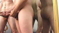 Two hot dudes strip off their clothes and stroke their dicks until they cum