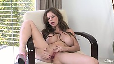 Busty brunette babe puts a smooth glass wand into her tight ass