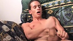 Handsome lads packing some mean wangs jerk off on their couch