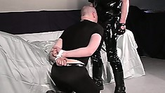 Latex wearing daddy Rob makes his man slave suck his cock and balls