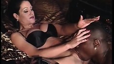 Sensual brunette in latex boots finds intense pleasure in a black cock