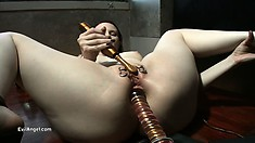 Slutty redhead with a fabulous ass stretches her tight anal hole with big dildos