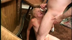 Mature blonde Kathy Jones has a stud pounding her pussy on the floor
