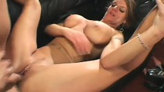 Big breasted milf has a young stud's hard dick pleasing her fiery twat