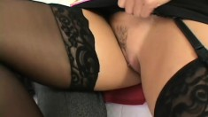 Tanned secretary in stockings plays with a big black schlong