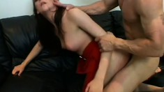 Brunette in a red dress gets some good loving on the couch and hot pussy slamming
