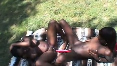Buxom black lesbians get together in the outdoors and fulfill their sexual desires