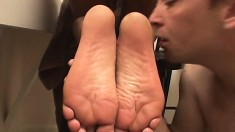 Chubby black stripper uses her feet to pleasure a massive dong