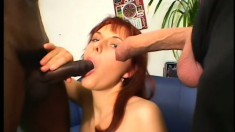 Buxom redhead enjoys to the fullest the hardcore interracial threesome