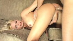 Lovely blonde shemale pumps her prick while taking one in from behind