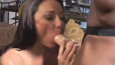 Long-legged brunette gets her pink butthole stretched with a sex toy