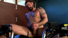 Handsome biker Vinny Castillo loses his clothes and pleases himself