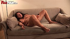 With her fingers and a dildo, the mature lady with big tits drive her snatch to orgasm
