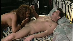 Buxom black girl has a white dude fucking her pussy all over the bed