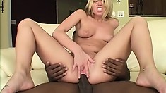 Stunning blonde with big boobs has a black stud fulfilling all her sexual desires