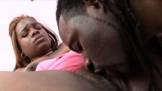 Chunky ebony girl in pink has a black stud satisfying her sexual needs