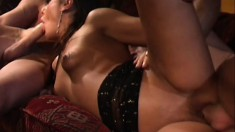 Two horny guys use their skewers to spit roast this hot brunette