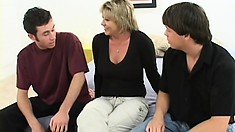 Busty mature blonde gets picked up and fucked hard by two young studs