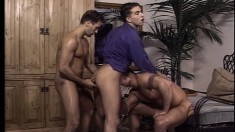 Three well-built dudes form a hot man-train in deep anal session